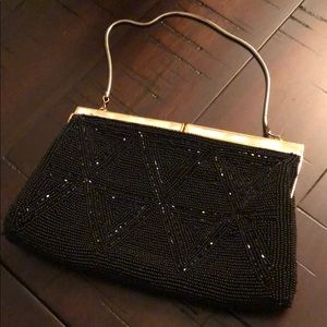 La Regale beaded bag with mother of pearl clasps